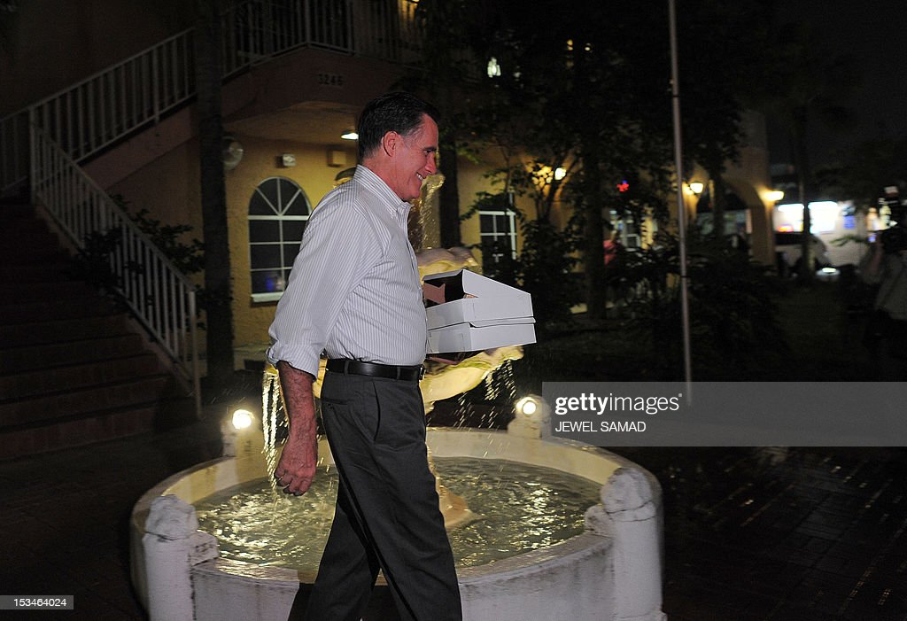 US Republican presidential candidate Mitt Romney carries two boxes of food he bought from La Terbsita restaurant on October 5, 2012 in Tampa, Florida. Fresh from a much-needed debate victory, Republican challenger Mitt Romney said his earlier remarks dismissing 47 percent of Americans as government dependents were 'completely wrong.' The admission came amid a campaign reset that shocked Democrat Barack Obama at Wednesday's debate, in which his invigorated rival for the White House vowed to fight for middle class families that Romney said were being 'crushed' by the president's policies. AFP PHOTO/Jewel Samad