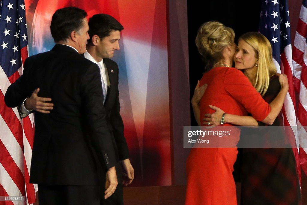 Republican presidential candidate, Mitt Romney greets Republican vice presidential candidate, U.S. Rep. Paul Ryan (R-WI) on stage while his wife, Ann Romney, and Janna Ryan hug after conceding the presidency during Mitt Romney's campaign election night event at the Boston Convention & Exhibition Center on November 7, 2012 in Boston, Massachusetts. After voters went to the polls in the heavily contested presidential race, networks projected incumbent U.S. President Barack Obama has won re-election against Republican candidate, former Massachusetts Gov. Mitt Romney.