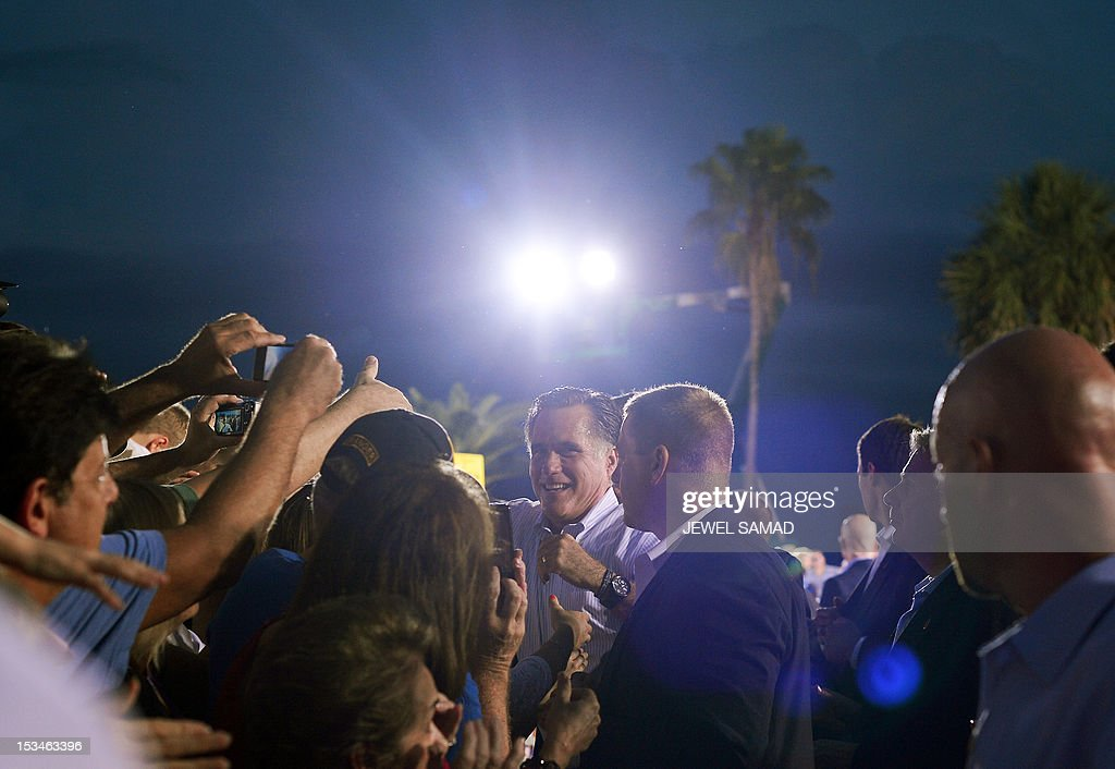 US Republican presidential candidate Mitt Romney greets supporters during a campaign event on October 5, 2012 in St. Petersburg, Florida. Fresh from a much-needed debate victory, Republican challenger Mitt Romney said his earlier remarks dismissing 47 percent of Americans as government dependents were 'completely wrong.' The admission came amid a campaign reset that shocked Democrat Barack Obama at Wednesday's debate, in which his invigorated rival for the White House vowed to fight for middle class families that Romney said were being 'crushed' by the president's policies. AFP PHOTO/Jewel Samad
