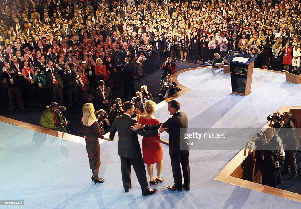 Republican presidential candidate, Mitt Romney (R), his wife Ann a (2nd R) and running mate U.S. Rep. Paul Ryan (R-WI) (2nd L) and his wife Janna on (L) stage after conceding the presidency during his campaign election night event at the Boston Convention & Exhibition Center on November 7, 2012 in Boston, Massachusetts. After voters went to the polls in the heavily contested presidential race, networks projected incumbent U.S. President Barack Obama has won re-election against Republican candidate, former Massachusetts Gov. Mitt Romney.
