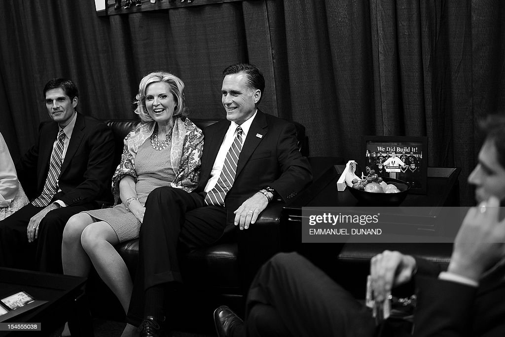 Republican Presidential candidate Mitt Romney (C), his wife Ann and son Matt (L) await in a holding room, the start of the second presidential debate at Hofstra University in Hempstead, New York, October 16, 2012. US President Barack Obama and Romney will face off in a town-hall style debate with undecided voters asking questions of the two candidates. AFP PHOTO/Emmanuel DUNAND