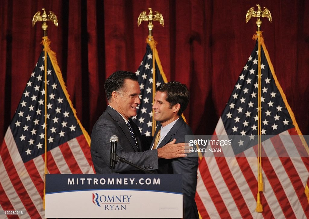 Republican presidential candidate Mitt Romney hugs his son Matt who introduced him as he arrives on stage to speak at a fundraiser at the Grand Del Mar Court resort September 22, 2012 in San Diego, California. AFP PHOTO/Mandel NGAN