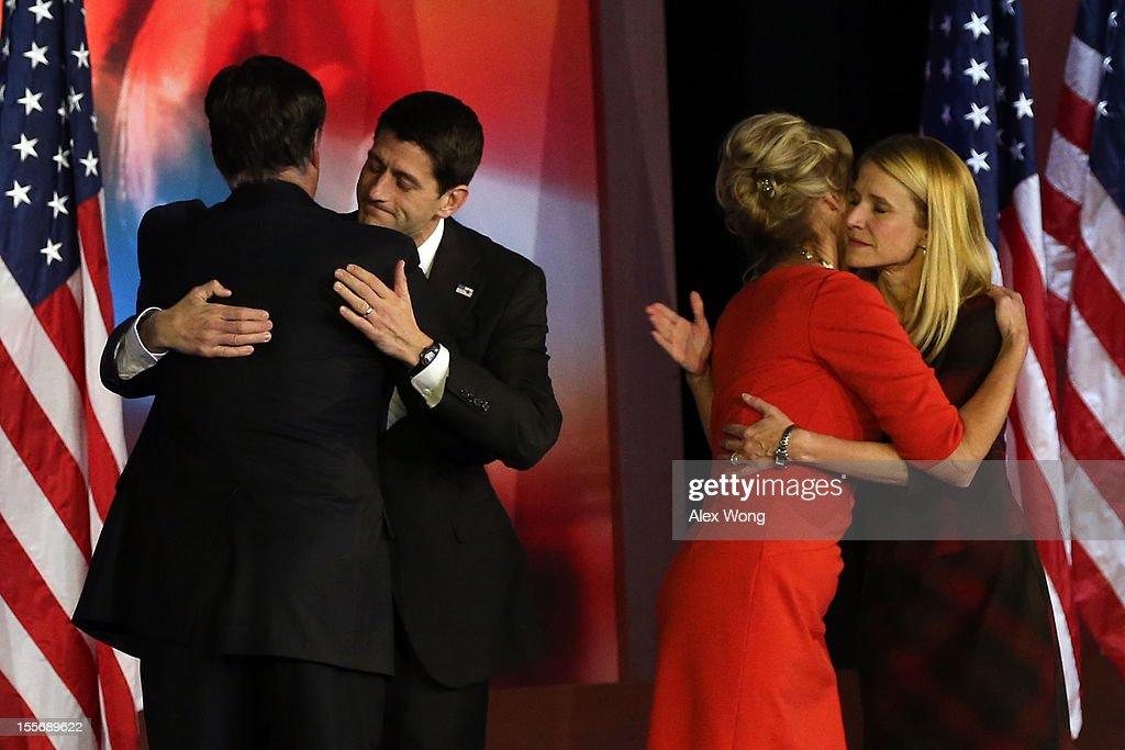 Republican presidential candidate, Mitt Romney, hugs Republican vice presidential candidate, U.S. Rep. Paul Ryan (R-WI) while his wife, Ann Romney, hugs Janna Ryan after conceding the presidency during Mitt Romney's campaign election night event at the Boston Convention & Exhibition Center on November 7, 2012 in Boston, Massachusetts. After voters went to the polls in the heavily contested presidential race, networks projected incumbent U.S. President Barack Obama has won re-election against Republican candidate, former Massachusetts Gov. Mitt Romney.