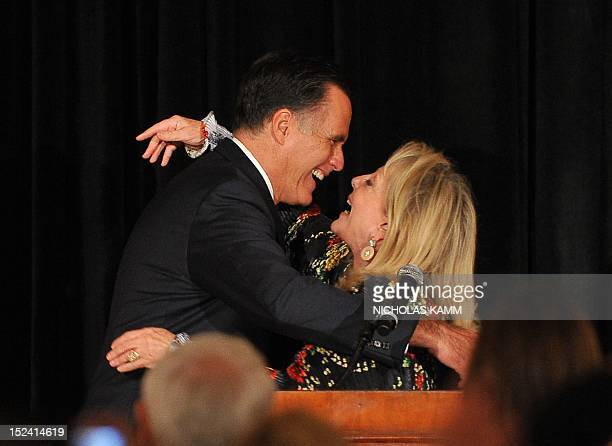 US Republican presidential candidate Mitt Romney is greeted by his former sisterinlaw Ronna Romney after she introduced him at a fundraiser in...