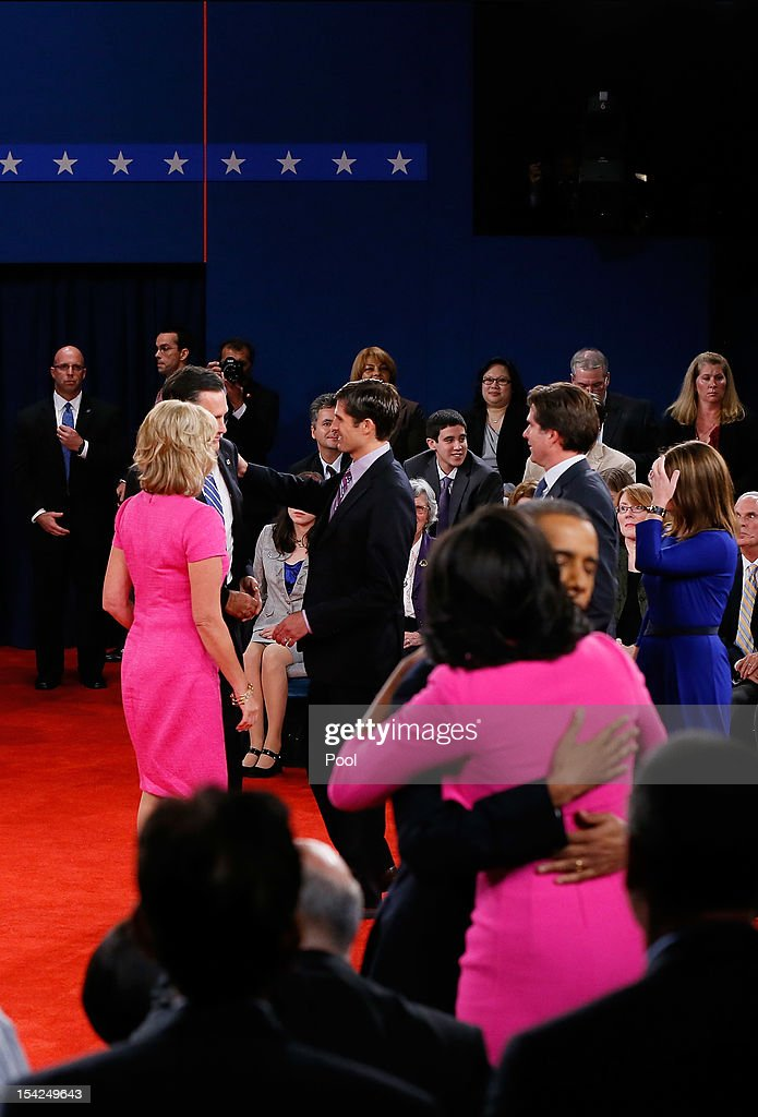 Republican presidential candidate Mitt Romney is greeted by his wife Ann Romney and son Matt Romney as U.S. President Barack Obama hugs wife Michelle Obama after a town hall style debate at Hofstra University October 16, 2012 in Hempstead, New York. During the second of three presidential debates, the candidates fielded questions from audience members on a wide variety of issues.