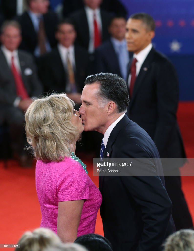 Republican presidential candidate <a gi-track='captionPersonalityLinkClicked' href=/galleries/search?phrase=Mitt+Romney&family=editorial&specificpeople=207106 ng-click='$event.stopPropagation()'>Mitt Romney</a> (C) kisses his wife <a gi-track='captionPersonalityLinkClicked' href=/galleries/search?phrase=Ann+Romney&family=editorial&specificpeople=868004 ng-click='$event.stopPropagation()'>Ann Romney</a> after a town hall style presidential debate at Hofstra University October 16, 2012 in Hempstead, New York. During the second of three presidential debates, the candidates fielded questions from audience members on a wide variety of issues.
