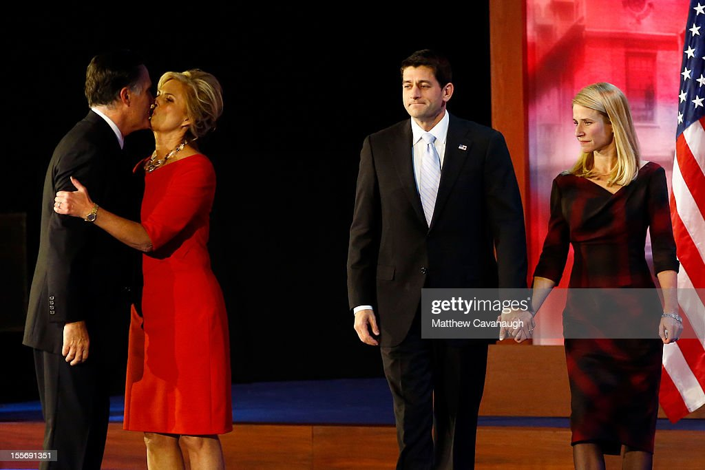 Republican presidential candidate, Mitt Romney, kisses his wife, Ann Romney, in front of Republican vice presidential candidate, U.S. Rep. Paul Ryan (R-WI) and wife, Janna Ryan, on stage after conceding the presidency during Mitt Romney's campaign election night event at the Boston Convention & Exhibition Center on November 7, 2012 in Boston, Massachusetts. After voters went to the polls in the heavily contested presidential race, networks projected incumbent U.S. President Barack Obama has won re-election against Republican candidate, former Massachusetts Gov. Mitt Romney.