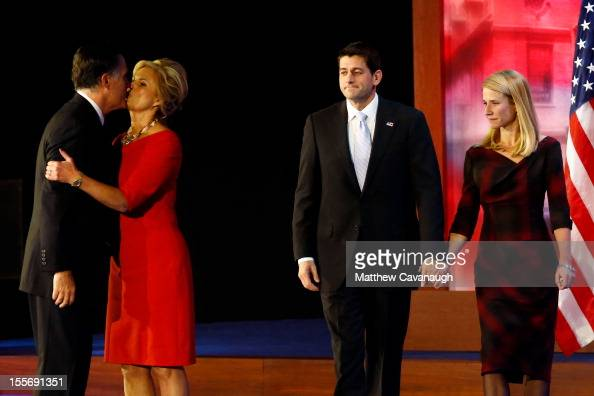 Republican presidential candidate Mitt Romney kisses his wife Ann Romney in front of Republican vice presidential candidate US Rep Paul Ryan and wife...