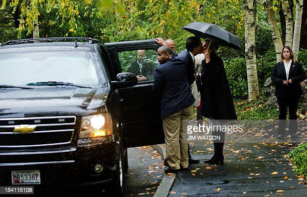 US Republican presidential candidate Mitt Romney kisses his wife Ann outside The Church of Jesus Christ of Latter Day Saints in Belmont MA October 14...