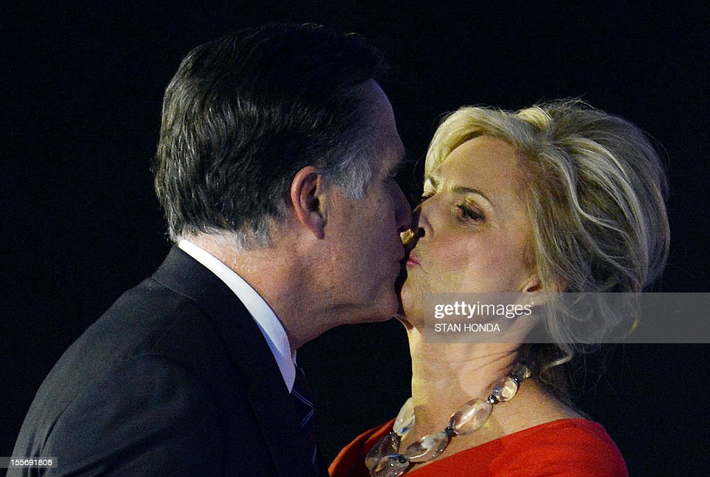 US Republican presidential candidate Mitt Romney kisses his wife Ann after conceding defeat to President Barack Obama on November 7, 2012 in Boston. Obama swept to re-election, forging history again by transcending a slow economic recovery and the high unemployment which haunted his first term to beat Romney. AFP PHOTO/Stan HONDA