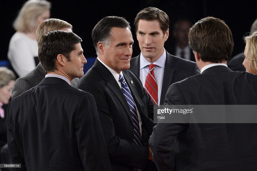 Republican presidential candidate <a gi-track='captionPersonalityLinkClicked' href=/galleries/search?phrase=Mitt+Romney&family=editorial&specificpeople=207106 ng-click='$event.stopPropagation()'>Mitt Romney</a> meets with his family on stage after a town hall style debate at Hofstra University October 16, 2012 in Hempstead, New York. During the second of three presidential debates, the candidates fielded questions from audience members on a wide variety of issues.