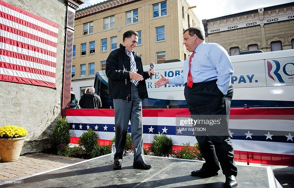 US Republican presidential candidate Mitt Romney (L) shakes hands with New Jersey Governor Chris Christie (R) as they talk with supporters at Buns Bakery and Restaurant in Delaware, Ohio, on October 10, 2012. AFP PHOTO/Jim WATSON