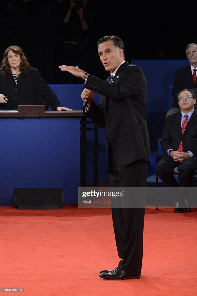 Republican presidential candidate Mitt Romney speaks as moderator Candy Crowley listens during a town hall style debate at Hofstra University October...
