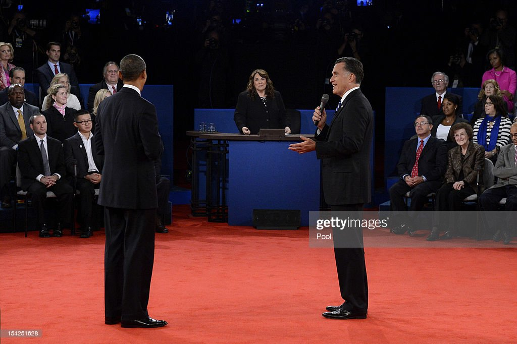 Republican presidential candidate <a gi-track='captionPersonalityLinkClicked' href=/galleries/search?phrase=Mitt+Romney&family=editorial&specificpeople=207106 ng-click='$event.stopPropagation()'>Mitt Romney</a> (R) speaks as U.S. President <a gi-track='captionPersonalityLinkClicked' href=/galleries/search?phrase=Barack+Obama&family=editorial&specificpeople=203260 ng-click='$event.stopPropagation()'>Barack Obama</a> (L) and moderator Candy Crowley (C) listen during a town hall style debate at Hofstra University October 16, 2012 in Hempstead, New York. During the second of three presidential debates, the candidates fielded questions from audience members on a wide variety of issues.