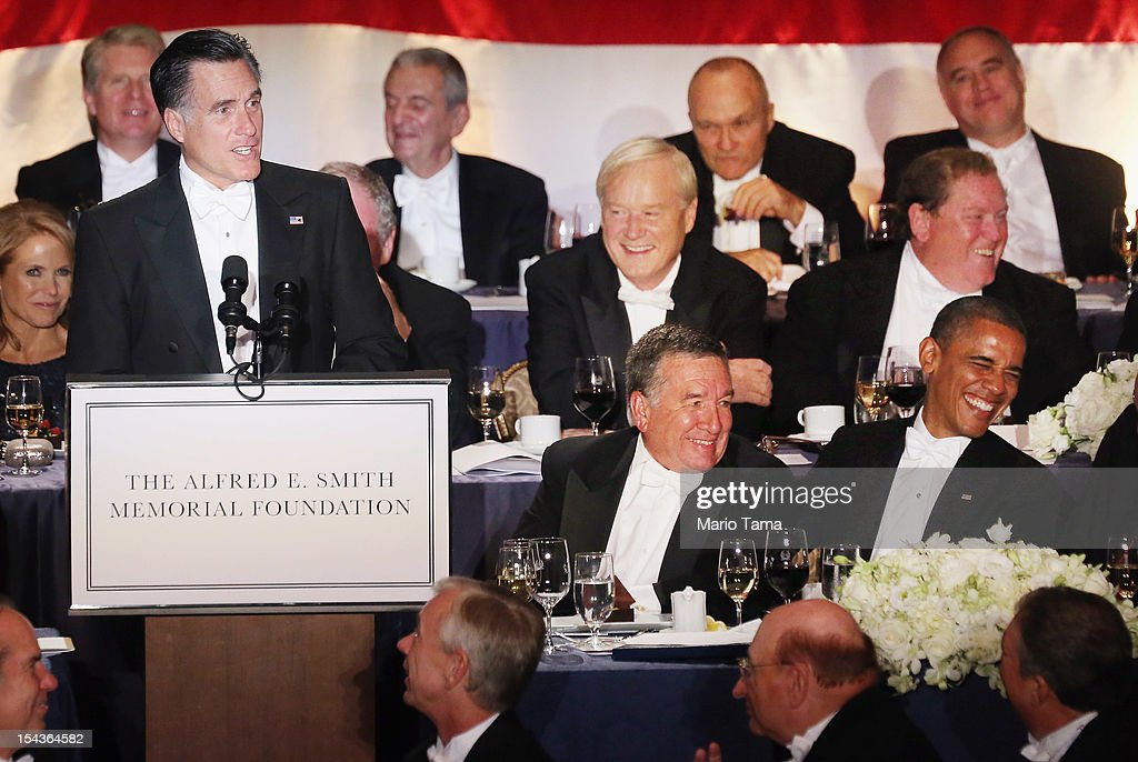Republican presidential candidate Mitt Romney (L) speaks as U.S. President Barack Obama (R) and Alfred E. Smith IV (C) laugh at the 67th Annual Alfred E. Smith Memorial Foundation Dinner at the Waldorf-Astoria Hotel on October 18, 2012 in New York City. The lighthearted white-tie charity gala has long been a tradition of the presidential race.
