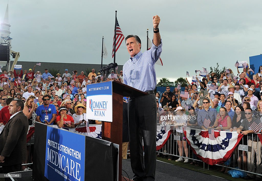 US Republican presidential candidate Mitt Romney speaks at a campaign rally in Port Saint Lucie, Florida, on October 7, 2012. US President Barack Obama's campaign intensified attacks on Romney's honesty as it tried to halt the Republican challenger's momentum after a strong first debate performance. Romney's people hit back, and did so sarcastically, depicting Obama's people as childish sore losers after he came across as flat, nervous and unassertive during their first face-to-face encounter in Denver. AFP PHOTO/Jewel Samad