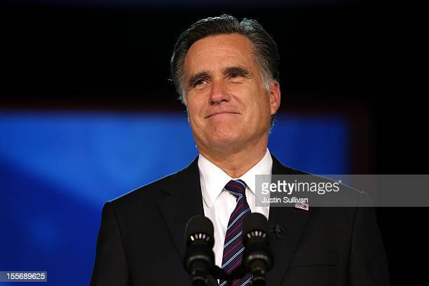 Republican presidential candidate Mitt Romney speaks at the podium as he concedes the presidency during Mitt Romney's campaign election night event...