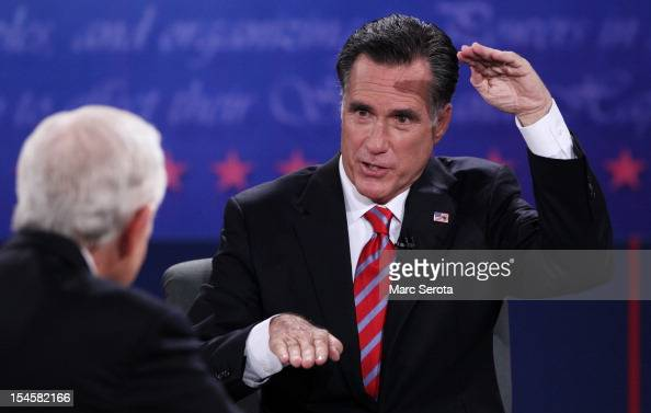 Republican presidential candidate Mitt Romney speaks during a debate with US President Barack Obama as moderator Bob Schieffer of CBS looks on at the...