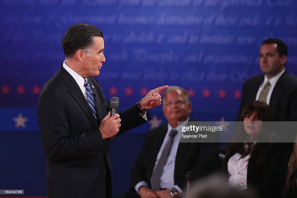 Republican presidential candidate Mitt Romney speaks during a town hall style debate at Hofstra University October 16, 2012 in Hempstead, New York. During the second of three presidential debates, the candidates fielded questions from audience members on a wide variety of issues.