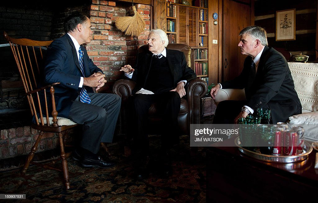 US Republican presidential candidate Mitt Romney (L) speaks with the Reverend Billy Graham (C) and his son Franklin (R) during a visit to the Graham's Cabin in Montreat, North Carolina, on October 11, 2012. AFP PHOTO/Jim WATSON