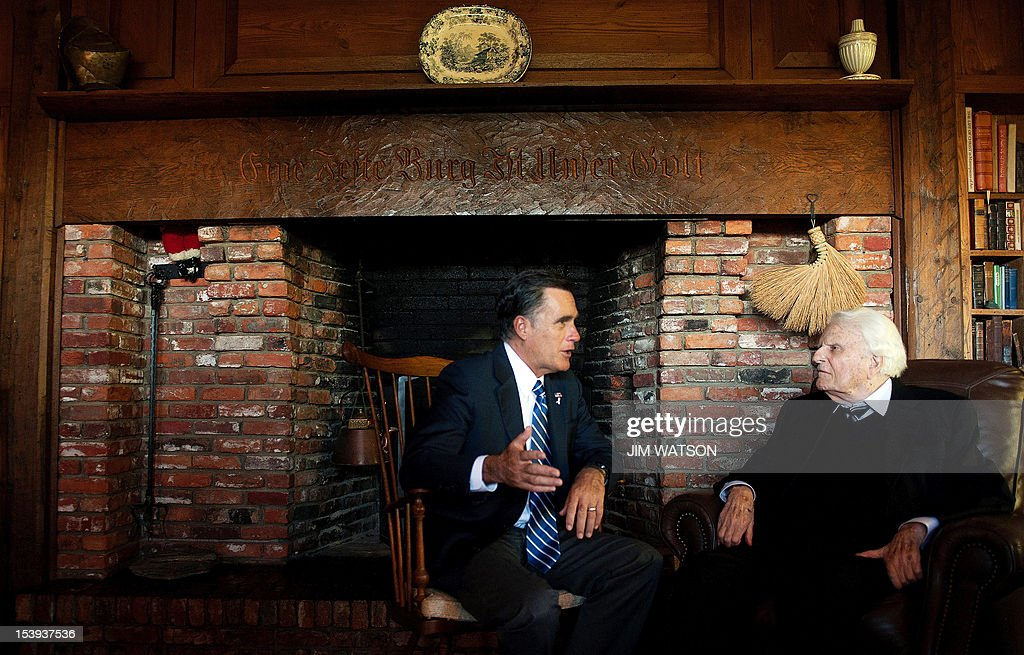 US Republican presidential candidate Mitt Romney (L) speaks with the Reverend Billy Graham (R) during a visit to the Graham cabin in Montreat, North Carolina, on October 11, 2012. AFP PHOTO/Jim WATSON
