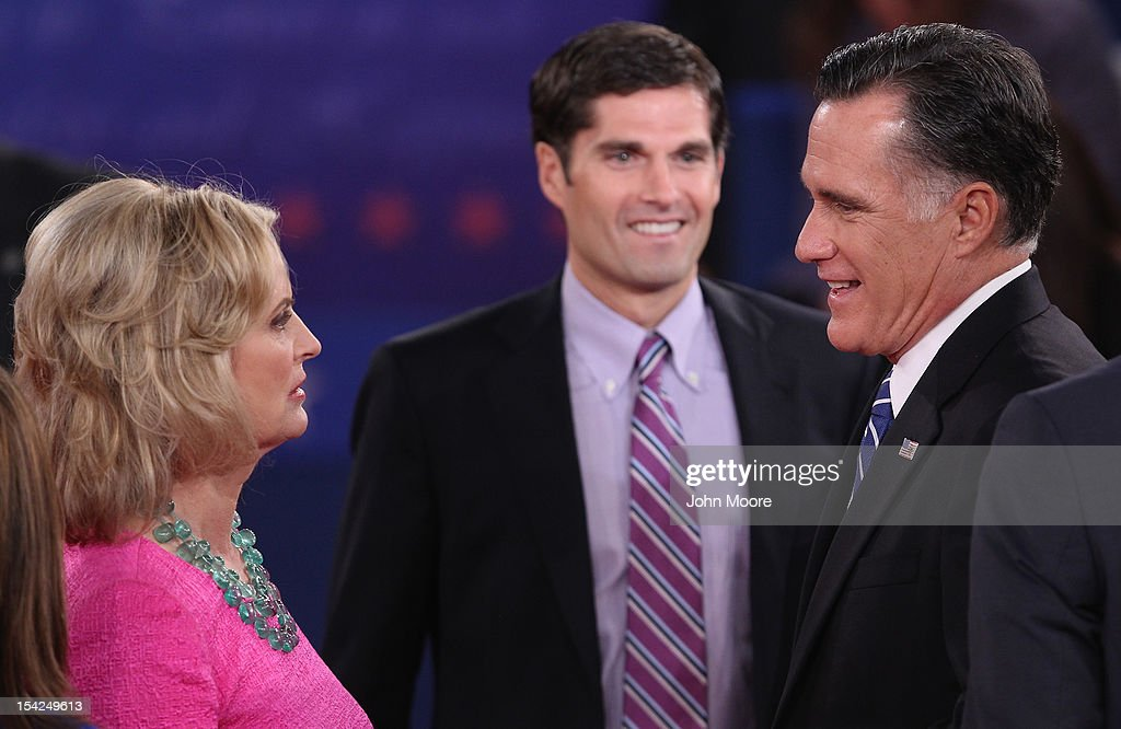 Republican presidential candidate Mitt Romney (R) speaks with wife Ann Romney, while son Matt Romney looks on after a town hall style debate at Hofstra University October 16, 2012 in Hempstead, New York. During the second of three presidential debates, the candidates fielded questions from audience members on a wide variety of issues.