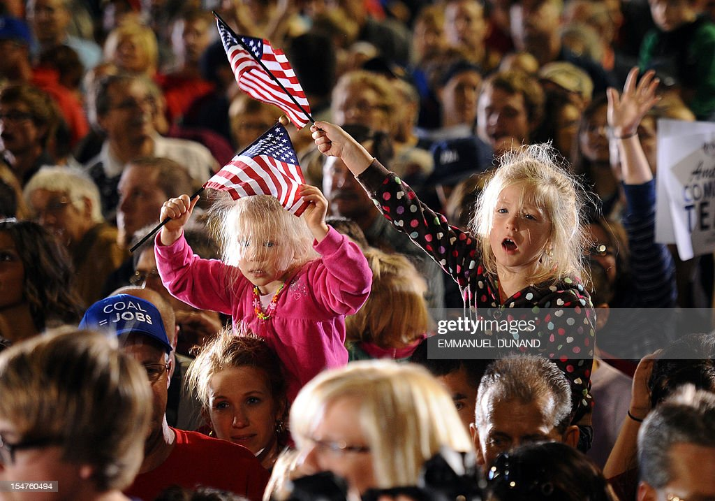 US Republican Presidential candidate Mitt Romney supporters attend a rally at Defiance High School, in Defiance, Ohio, October 25, 2012. AFP PHOTO/Emmanuel DUNAND