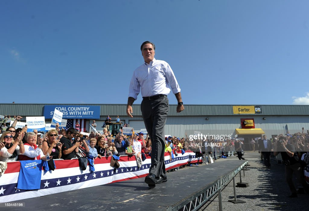 US Republican presidential candidate Mitt Romney walks on the stage during a campaign event on October 5, 2012 in Abingdon, Virginia. Fresh from a much-needed debate victory, Republican challenger Mitt Romney said his earlier remarks dismissing 47 percent of Americans as government dependents were 'completely wrong.' The admission came amid a campaign reset that shocked Democrat Barack Obama at Wednesday's debate, in which his invigorated rival for the White House vowed to fight for middle class families that Romney said were being 'crushed' by the president's policies. AFP PHOTO/Jewel Samad