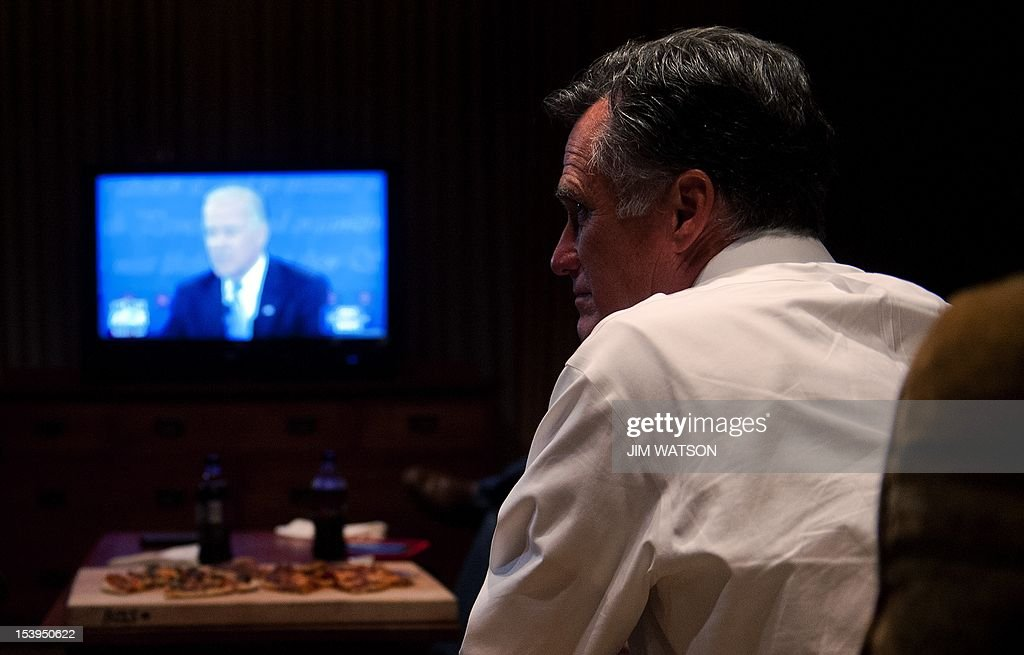 US Republican presidential candidate Mitt Romney (R) watches the Vice Presidential Debate at his hotel in Asehville, North Carolina, October 11, 2012. AFP PHOTO/Jim WATSON