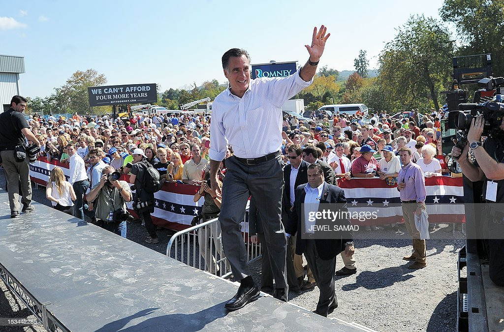 US Republican presidential candidate Mitt Romney waves during a campaign event on October 5, 2012 in Abingdon, Virginia. Fresh from a much-needed debate victory, Republican challenger Mitt Romney said his earlier remarks dismissing 47 percent of Americans as government dependents were 'completely wrong.' The admission came amid a campaign reset that shocked Democrat Barack Obama at Wednesday's debate, in which his invigorated rival for the White House vowed to fight for middle class families that Romney said were being 'crushed' by the president's policies. AFP PHOTO/Jewel Samad