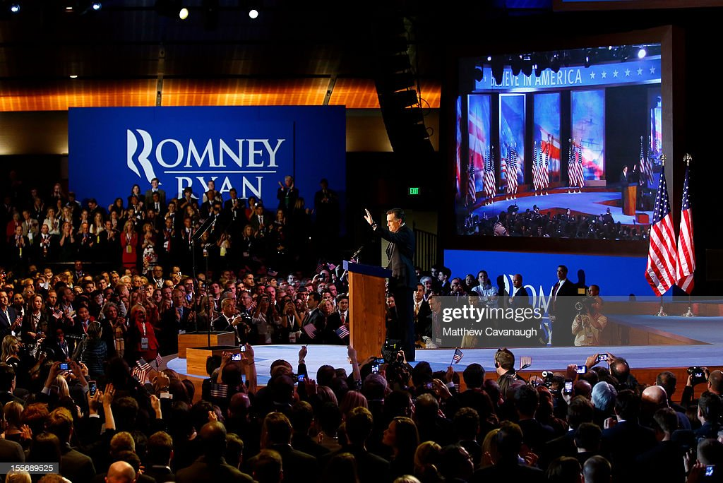 Republican presidential candidate, <a gi-track='captionPersonalityLinkClicked' href=/galleries/search?phrase=Mitt+Romney&family=editorial&specificpeople=207106 ng-click='$event.stopPropagation()'>Mitt Romney</a>, waves to the crowd while standing at the podium before conceding the presidency during <a gi-track='captionPersonalityLinkClicked' href=/galleries/search?phrase=Mitt+Romney&family=editorial&specificpeople=207106 ng-click='$event.stopPropagation()'>Mitt Romney</a>'s campaign election night event at the Boston Convention & Exhibition Center on November 7, 2012 in Boston, Massachusetts. After voters went to the polls in the heavily contested presidential race, networks projected incumbent U.S. President Barack Obama has won re-election against Republican candidate, former Massachusetts Gov. <a gi-track='captionPersonalityLinkClicked' href=/galleries/search?phrase=Mitt+Romney&family=editorial&specificpeople=207106 ng-click='$event.stopPropagation()'>Mitt Romney</a>.