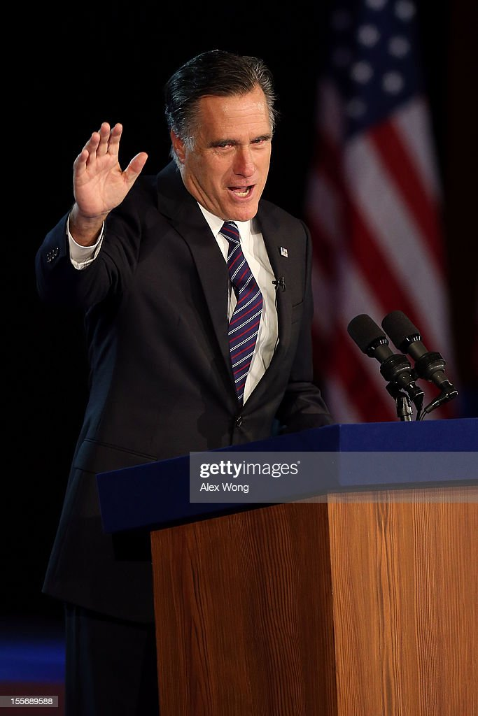 Republican presidential candidate, <a gi-track='captionPersonalityLinkClicked' href=/galleries/search?phrase=Mitt+Romney&family=editorial&specificpeople=207106 ng-click='$event.stopPropagation()'>Mitt Romney</a>, waves to the crowd while speaking at the podium as he concedes the presidency during <a gi-track='captionPersonalityLinkClicked' href=/galleries/search?phrase=Mitt+Romney&family=editorial&specificpeople=207106 ng-click='$event.stopPropagation()'>Mitt Romney</a>'s campaign election night event at the Boston Convention & Exhibition Center on November 7, 2012 in Boston, Massachusetts. After voters went to the polls in the heavily contested presidential race, networks projected incumbent U.S. President Barack Obama has won re-election against Republican candidate, former Massachusetts Gov. <a gi-track='captionPersonalityLinkClicked' href=/galleries/search?phrase=Mitt+Romney&family=editorial&specificpeople=207106 ng-click='$event.stopPropagation()'>Mitt Romney</a>.