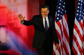Republican presidential candidate Mitt Romney waves to the crowd before conceding the presidency during Mitt Romney's campaign election night event...