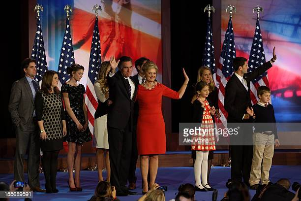 Republican presidential candidate Mitt Romney wife Ann Romney and family wave to the crowd on stage after conceding the presidency during Mitt...