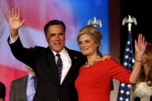 Republican presidential candidate Mitt Romney wife Ann Romney wave to the crowd on stage after conceding the presidency during Mitt Romney's campaign...