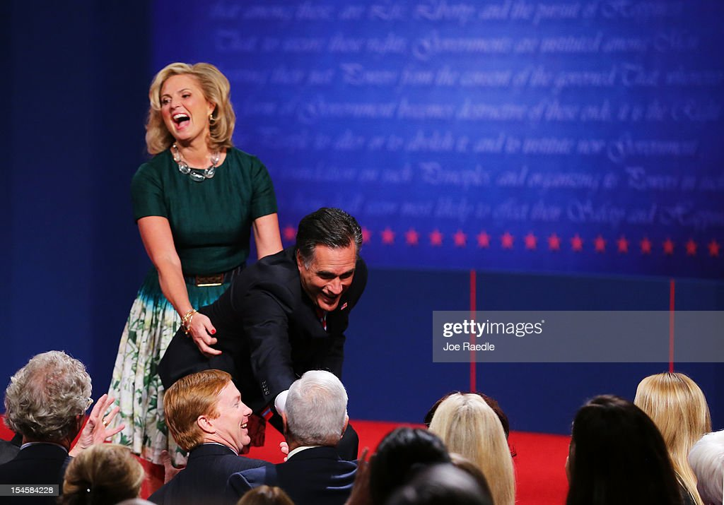 Republican presidential candidate <a gi-track='captionPersonalityLinkClicked' href=/galleries/search?phrase=Mitt+Romney&family=editorial&specificpeople=207106 ng-click='$event.stopPropagation()'>Mitt Romney</a> with wife, <a gi-track='captionPersonalityLinkClicked' href=/galleries/search?phrase=Ann+Romney&family=editorial&specificpeople=868004 ng-click='$event.stopPropagation()'>Ann Romney</a> greet people on stage after the debate at the Keith C. and Elaine Johnson Wold Performing Arts Center at Lynn University on October 22, 2012 in Boca Raton, Florida. The focus for the final presidential debate before Election Day on November 6 is foreign policy.