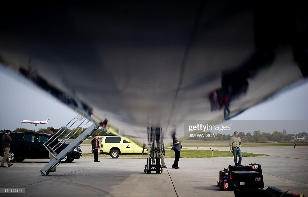 US Republican presidential candidate Mitt Romney's staff members take equipment off the campaign plane at the Newport News Williamsburg International...