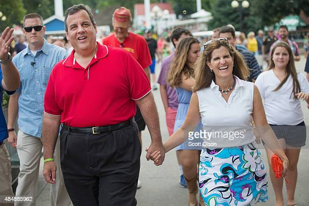 Republican presidential candidate New Jersey Governor Chris Christie and his wife Mary Pat Foster tour the Iowa State Fair on August 22 2015 in Des...