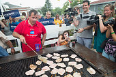 Republican presidential candidate New Jersey Governor Chris Christie takes a turn at the grill at the Iowa Pork Producers Tent at the Iowa State Fair...