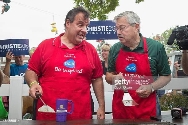 Republican presidential candidate New Jersey Governor Chris Christie and Iowa Governor Terry Branstad help to cook pork at the Iowa Pork Producers...