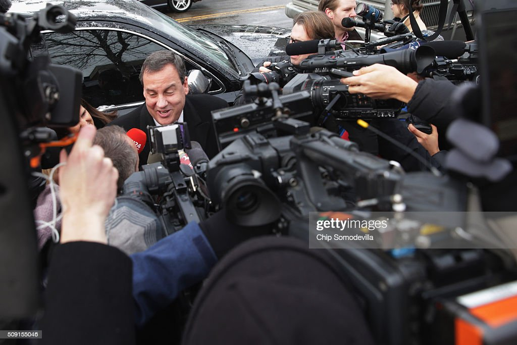 Republican presidential candidate New Jersey Governor <a gi-track='captionPersonalityLinkClicked' href=/galleries/search?phrase=Chris+Christie&family=editorial&specificpeople=6480114 ng-click='$event.stopPropagation()'>Chris Christie</a> is surrounded by journalists as he arrives outside the polling place at Webster School February 9, 2016 in Manchester, New Hampshire. Candidates from both parties are making last-minute attempts to swing voters to their side on the day of the 'First in the Nation' presidential primary.