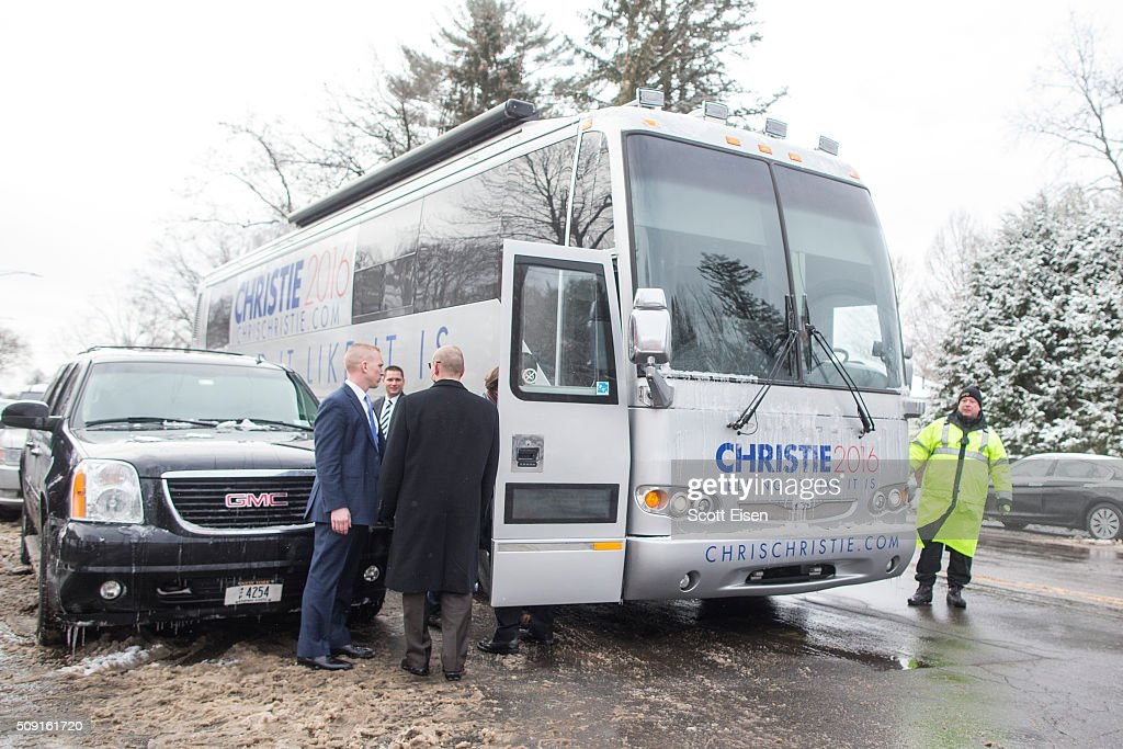 Republican presidential candidate New Jersey Governor Chris Christie's bus is guarded by secuirty while he meets voters outside the polling place at Webster School February 9, 2016 in Manchester, New Hampshire. Candidates from both parties are making last-minute attempts to swing voters to their side on the day of the 'First in the Nation' presidential primary.