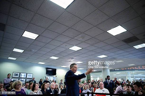 Republican presidential candidate Ohio Gov John Kasich addresses a town hallstyle meeting in the Hazel Hall Atrium at the George Mason University Law...