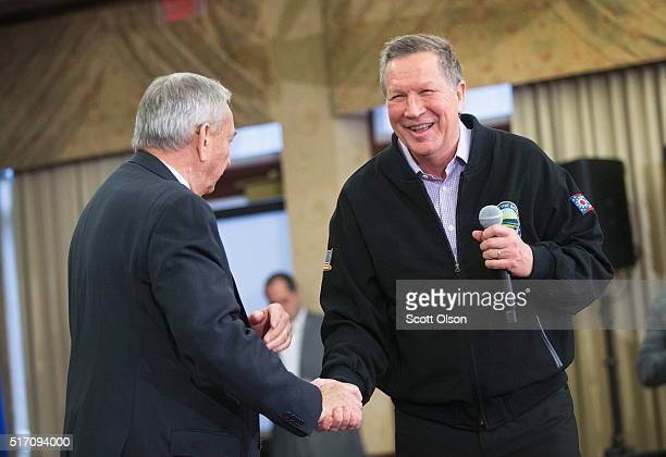 Republican presidential candidate Ohio Gov John Kasich is introduced at a campaign rally by former Wisconsin Gov Tommy Thompson at the Crowne Plaza...