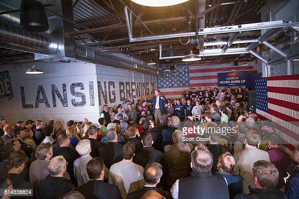 Republican presidential candidate Ohio Gov John Kasich speaks at a campaign rally at the Lansing Brewing Company on March 8 2016 in Lansing Michigan...