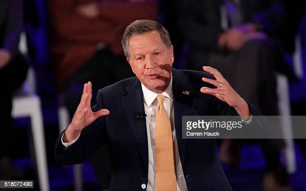 Republican Presidential candidate Ohio Gov John Kasich takes part in a town hall event moderated by Anderson Cooper March 29 2016 in Milwaukee...