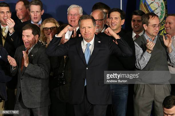 Republican presidential candidate Ohio Governor John Kasich arrives on stage at a campaign gathering with supporters upon placing second place in the...
