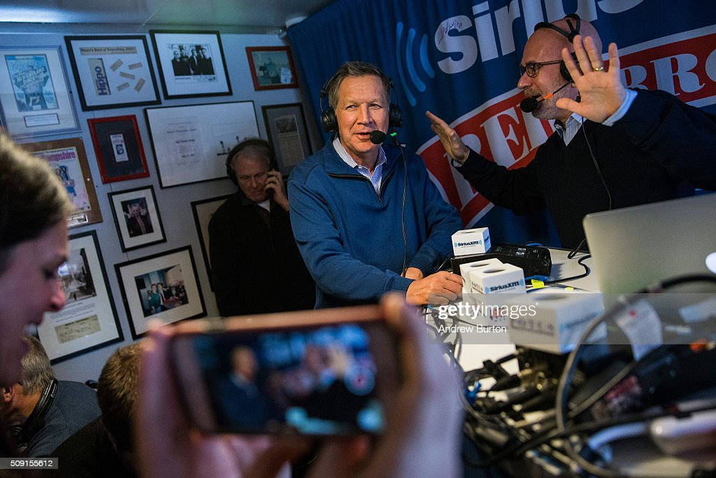 Republican presidential candidate Ohio Governor <a gi-track='captionPersonalityLinkClicked' href=/galleries/search?phrase=John+Kasich&family=editorial&specificpeople=1315571 ng-click='$event.stopPropagation()'>John Kasich</a> gives an interview on Sirius radio at the Red arrow Diner on February 9, 2016 in Manchester, New Hampshire. Today New Hampshire voters will decide between Republican and Democratic nominees for the presidency.