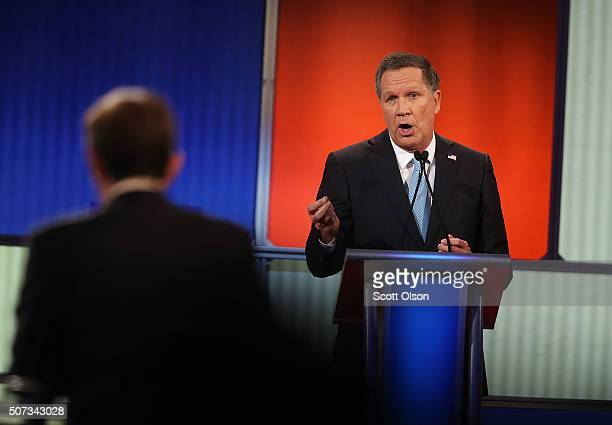 Republican presidential candidate Ohio Governor John Kasich participates in the Fox News Google GOP Debate January 28 2016 at the Iowa Events Center...