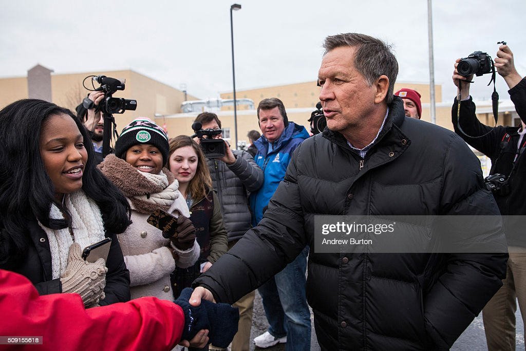 Republican presidential candidate Ohio Governor <a gi-track='captionPersonalityLinkClicked' href=/galleries/search?phrase=John+Kasich&family=editorial&specificpeople=1315571 ng-click='$event.stopPropagation()'>John Kasich</a> shakes hands with voters outside Manchester High School, a voting location for the New Hampshire state primary, on February 9, 2016 in Manchester, New Hampshire. Today New Hampshire voters will decide between Republican and Democratic nominees for the presidency.